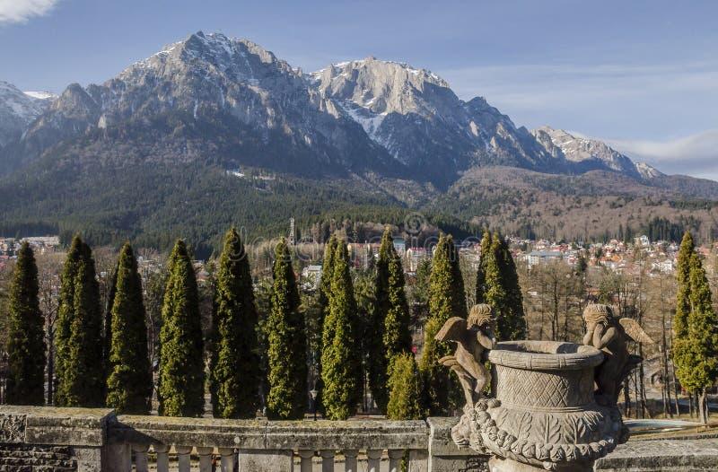 Bucegi Mountains, seen from Cantacuzino Palace yard stock image
