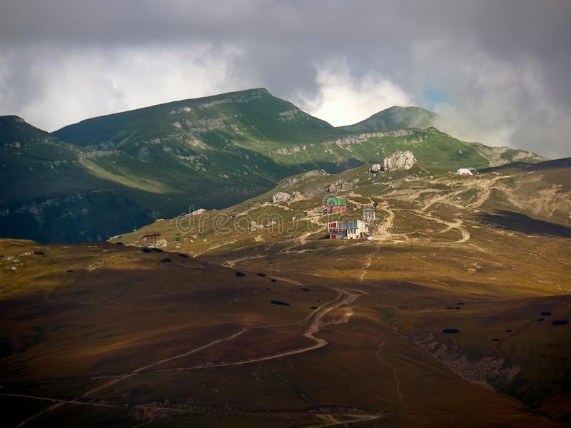 Bucegi Plateau in Romania. Bucegi Plateau, showing the Busteni superior cable car station, Babele Chalet, and many of the strange rock formations: the Sphinx royalty free stock photography