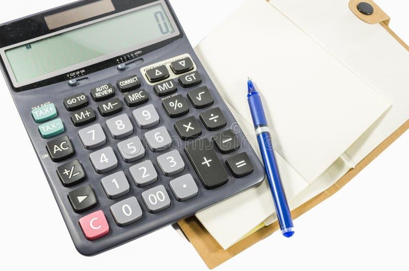 Buch und Stift auf weißem Hintergrund stockfotografie