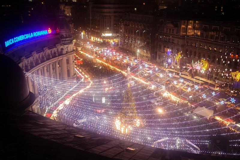 Bucharest Christmas Fair from Universitatii Square. Decorated with lights stock photography