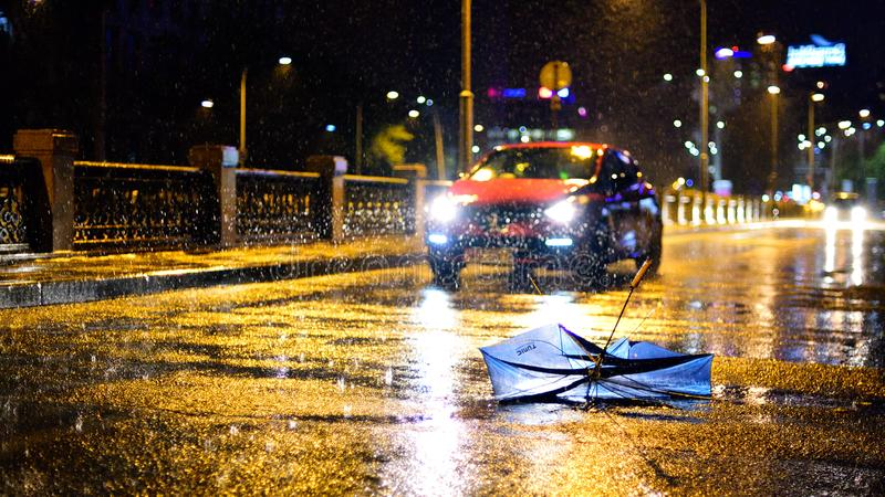 Bucharest city after heavy rain during the summer time. Car crossing the flood , bad whether, umbrella stock photography