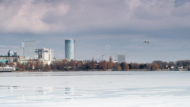 Bucharest cityscape with storm clouds and Herastrau  park stock photos