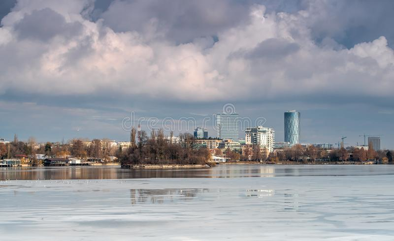Bucharest cityscape with storm clouds and Herastrau  park royalty free stock image