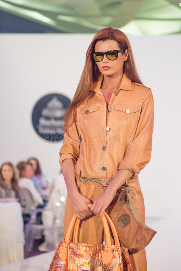 Bucharest Fashion Week 2015. Fashion models presents clothes creation made by different disigners at Bucharest Fashion Week, and the contest for Best Romanian stock photos