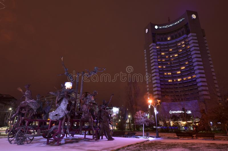 Bucharest Intercontinental hotel night scene. Bucharest, Romania - March 18, 2018: Night view on Bucharest Intercontinental hotel and sculptural composition