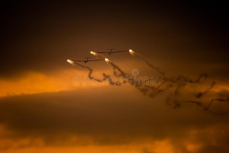 Bucharest international air show BIAS, air glider duo aerobatic team silhouette royalty free stock photo
