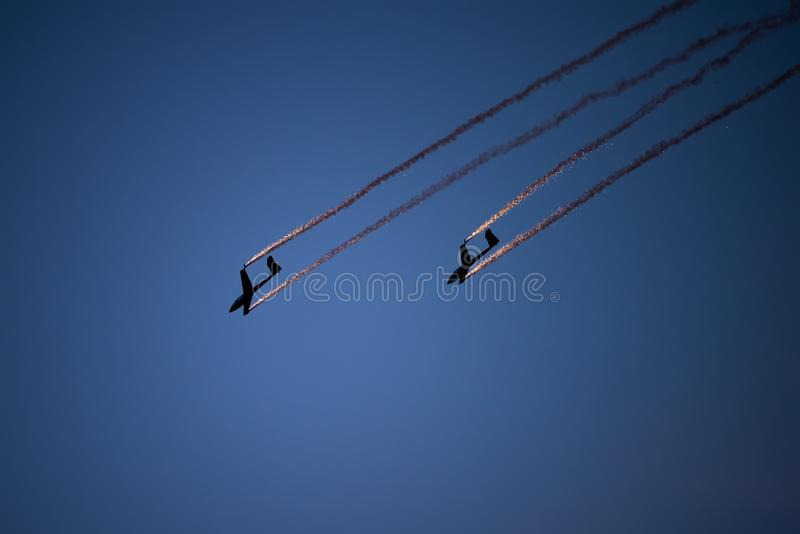 Bucharest international air show BIAS, air glider duo aerobatic team silhouette royalty free stock photos