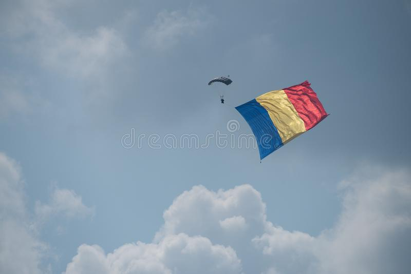 Bucharest international air show BIAS, parachute troopers with Romanian national flag stock image