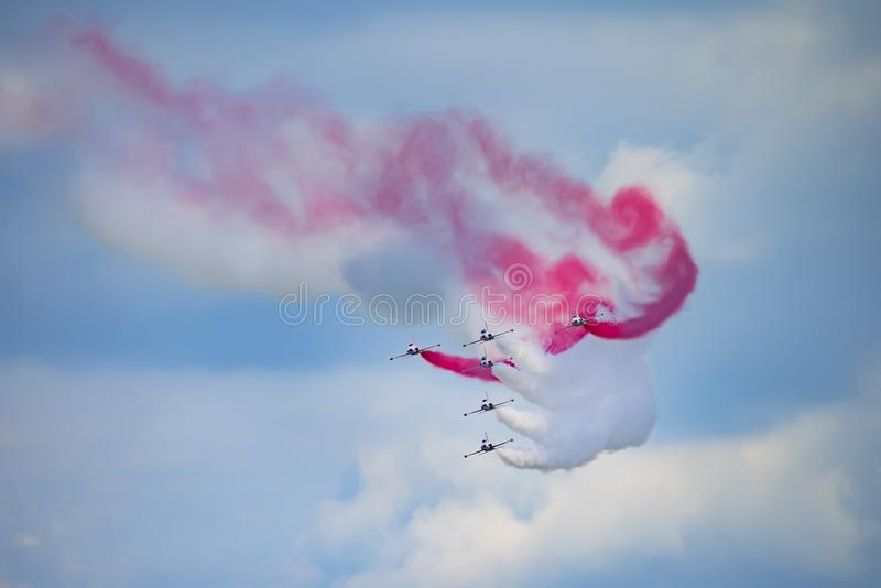 Bucharest international air show BIAS, white red sparks Poland aerobatic display team. Bucharest international air show BIAS, white red sparks Poland aerobatic royalty free stock image