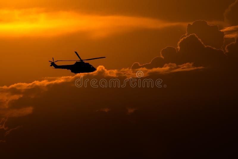 Bucharest international air show helicopter silhouette in the sunset stock photo
