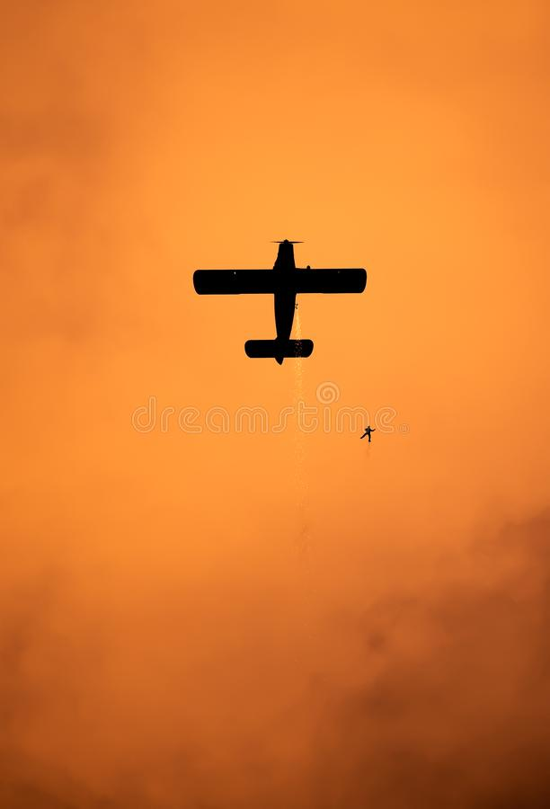 Bucharest international air show skydiving at sunset BIAS royalty free stock photos