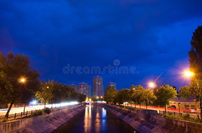 Bucharest by night - Dambovita River stock photo
