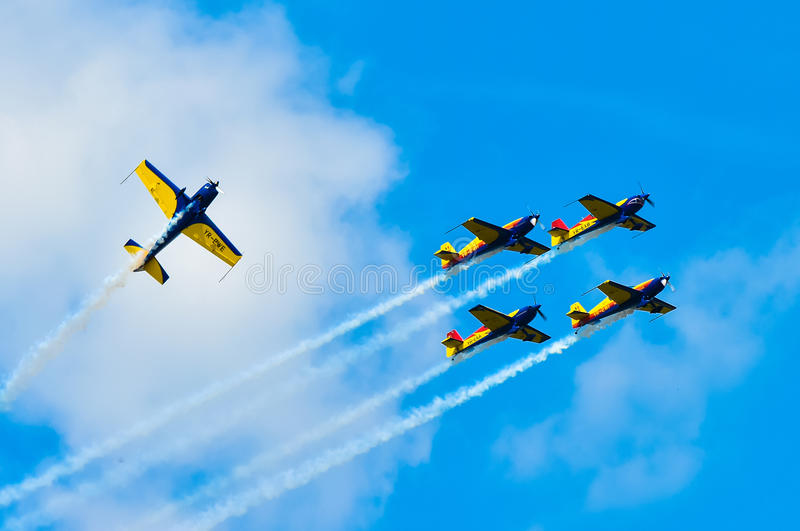 BUCHAREST, ROMANIA, 2015: Acrobatic planes at Bucharest International Air Show (BIAS) with blue sky background stock photos