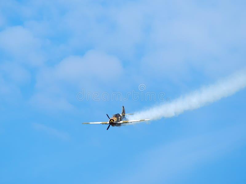 Bucharest, Romania - 9/15/2018: `AeroNautic Show 2018` at Lacul Morii, Bucuresti, Romania - Performance from team `Iacarii acrobat. I` on Yakovlev Yak-52 royalty free stock image