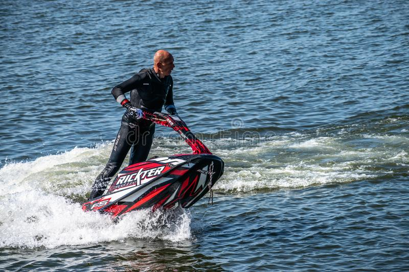 Bucharest/ Romania - AeroNautic Show - September 21, 2019: JetSki FreeStyle Team doing some incredible tricks.  stock photo