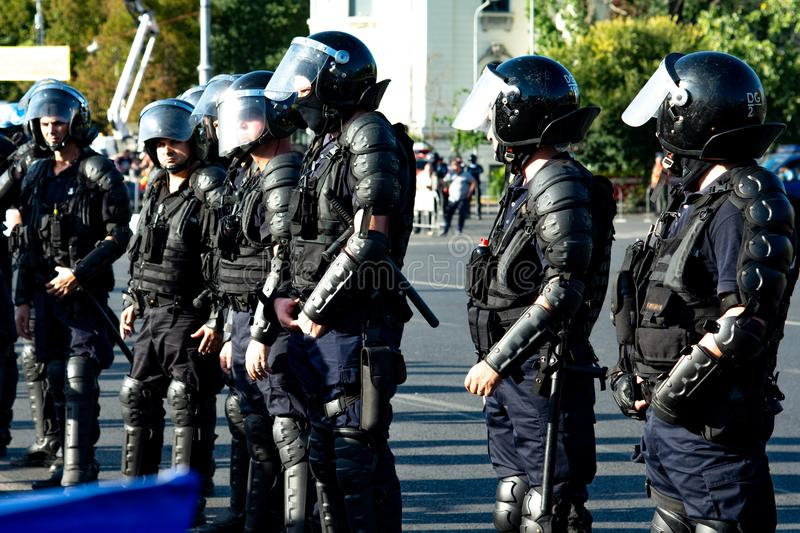 Riot police prepared to supress the manifestation. Bucharest, Romania - 10 August 2018: Riot police prepared to supress the manifestation during the protest of royalty free stock images