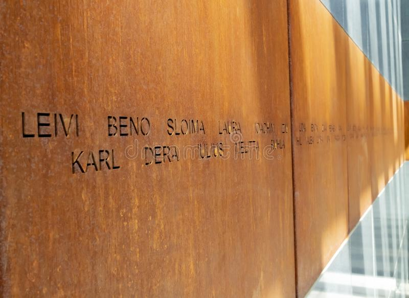 Holocaust Memorial, Bucharest, Romania. Bucharest, Romania - August 13th, 2018: Victims names written on rusty metal walls in the holocaust memorial in Bucharest royalty free stock photos