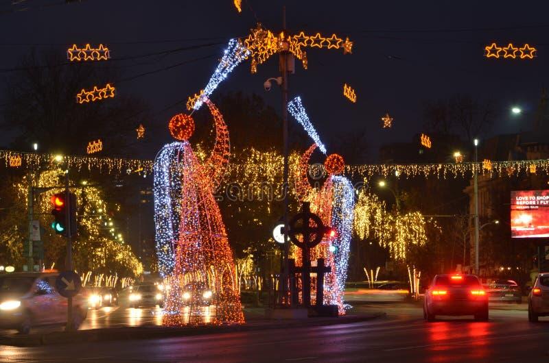 Christmas illumination in Bucharest Romana Square. Bucharest, Romania - December 8, 2018: Original ornamental Christmas illumination in Romana Square. Busy royalty free stock photography
