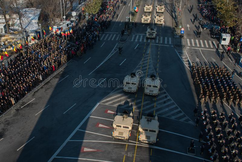 Military parade celebrating Romania`s National Day. Bucharest, Romania - December 01, 2018: Romanian Army`s soldiers march in front of the Triumph Arch during a stock photos