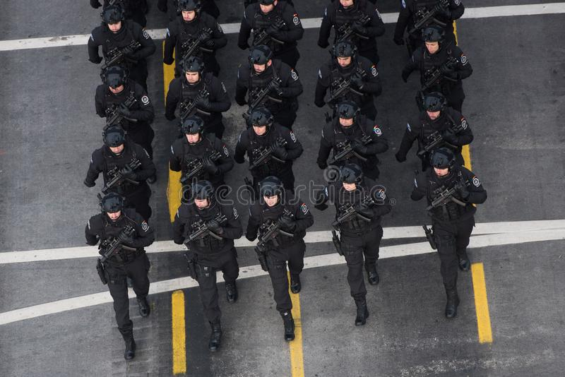 Military parade celebrating Romania`s National Day. Bucharest, Romania - December 01, 2018: Romanian Army`s soldiers march in front of the Triumph Arch during a stock photo