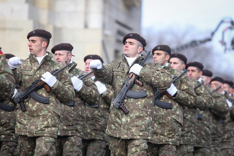 Romanian army soldiers are armed with AK-47 assault rifles. Bucharest, Romania - December 1, 2018: Romanian army soldiers, armed with AK-47 assault rifles, take royalty free stock images