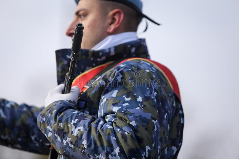 Romanian army soldiers are armed with AK-47 assault rifles. Bucharest, Romania - December 1, 2018: Romanian army soldiers, armed with AK-47 assault rifles, take royalty free stock photos