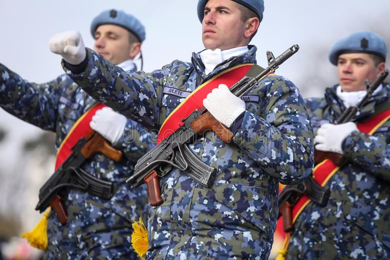 Romanian army soldiers are armed with AK-47 assault rifles. Bucharest, Romania - December 1, 2018: Romanian army soldiers, armed with AK-47 assault rifles, take stock photography