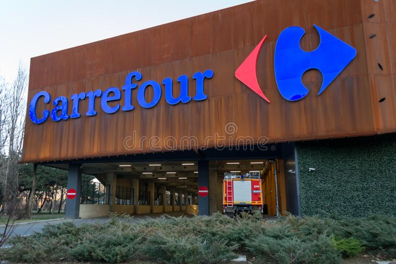 Carrefour supermarket logo on ParkLake Shopping Center mall. Carrefour is one of the largest hypermarket chains in the world. Bucharest, Romania - 26 February stock photography