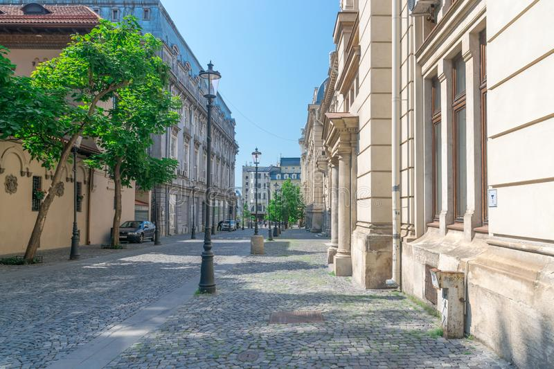 BUCHAREST, ROMANIA - 27 JULY, 2019: A empty street on a sunny summer day in the historic center of Bucharest, Romania. Beautiful stock photo
