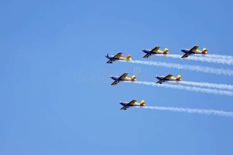 Airplanes performing acrobatic flight on blue sky. Trace of Smoke behind royalty free stock photo