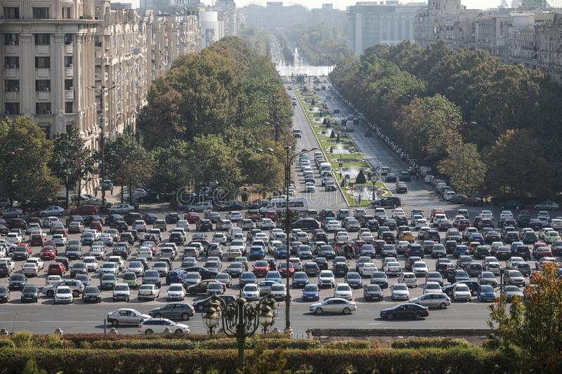 Car traffic and a big parking lot in Piata Constitutiei Constitution Square in downtown Bucharest, as seen from the Palace of. Bucharest, Romania - October 1 royalty free stock images