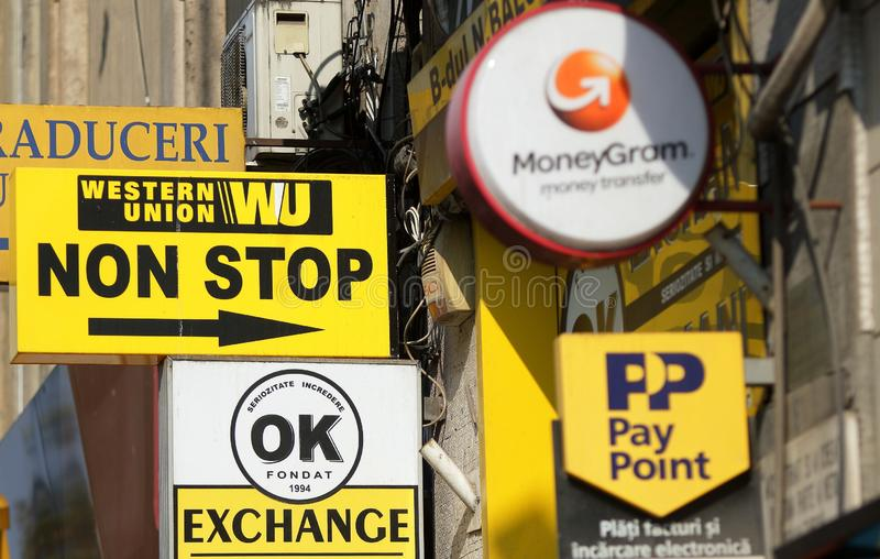 Western Union, MoneyGram and Pay Point commercials. Bucharest, Romania - October 10, 2018: Several Western Union, MoneyGram and Pay Point commercials are seen on stock image