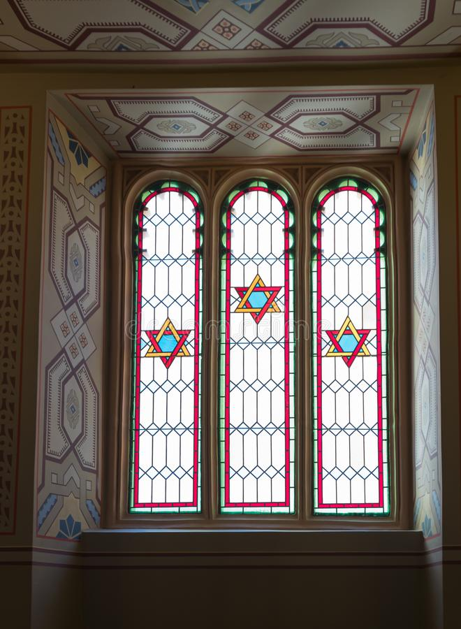 Window decorated with stained glass in the synagogue Coral in Bucharest city in Romania royalty free stock photo