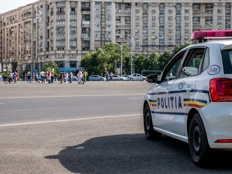 Police cars closely supervising the demonstrators from Piata Victoriei Square who gathered to protest against the coronavirus royalty free stock image
