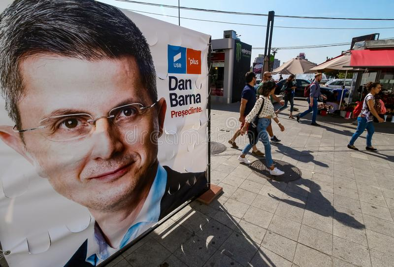 Dan Barna - race for the presidential mandate - Romanian politics. Bucharest, Romania - September 19, 2019: People pass by a billboard of the presidential stock photos