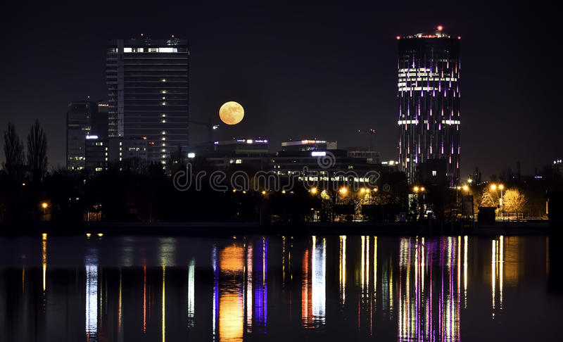 BUCHAREST SKYTOWER Romania by night from Herastrau Lake royalty free stock images