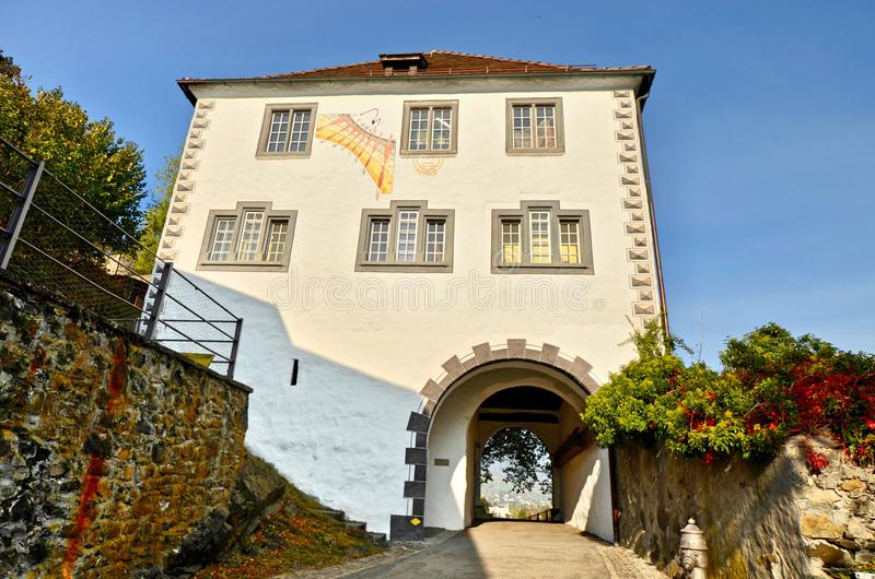 Historic Gatehouse building in Buchs - St. Gallen, Switzerland. Buchs, St. Gallen / Switzerland - October 22nd 2018: Entrance/Gatehouse into the medieval royalty free stock photo