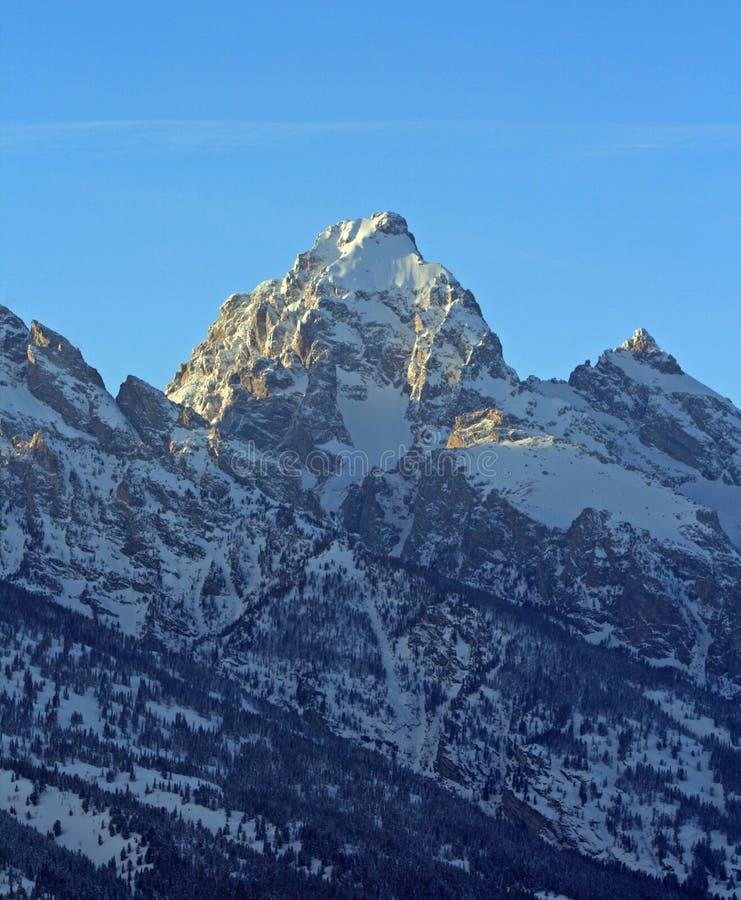 Buck Mountain på solnedgången med cirrusmolnmoln som är över huvudet i den storslagna Teton bergskedjan i den storslagna Tetons n royaltyfria foton