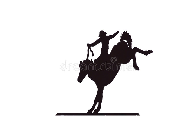 Buckaroos - cowboy on bucking bronco stock photography