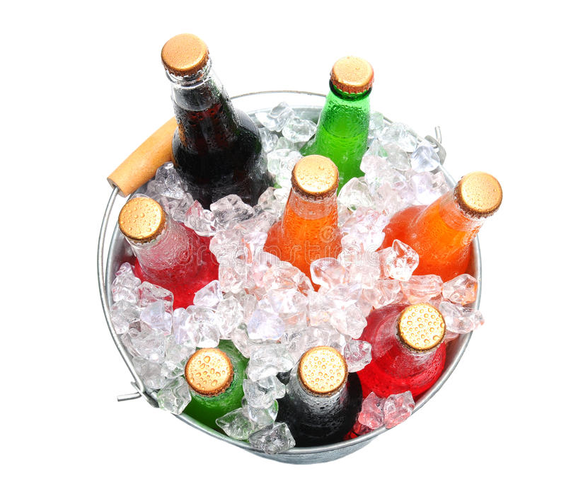 Bucket of Assorted Soda Bottles. Top view of a bucket full of ice and soda bottles. Isolated over a white background royalty free stock photography