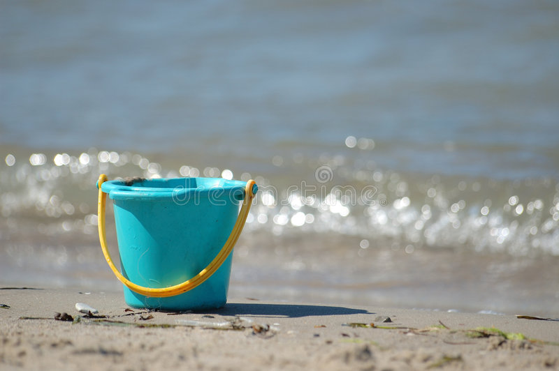 Bucket on beach royalty free stock photos