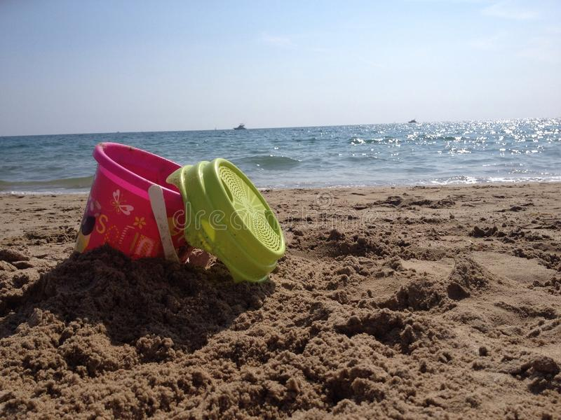 Bucket on a beach stock photo