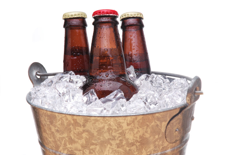 Bucket of Beer. Galvanized Bucket with Three Bottles of Beer isolated over white stock images