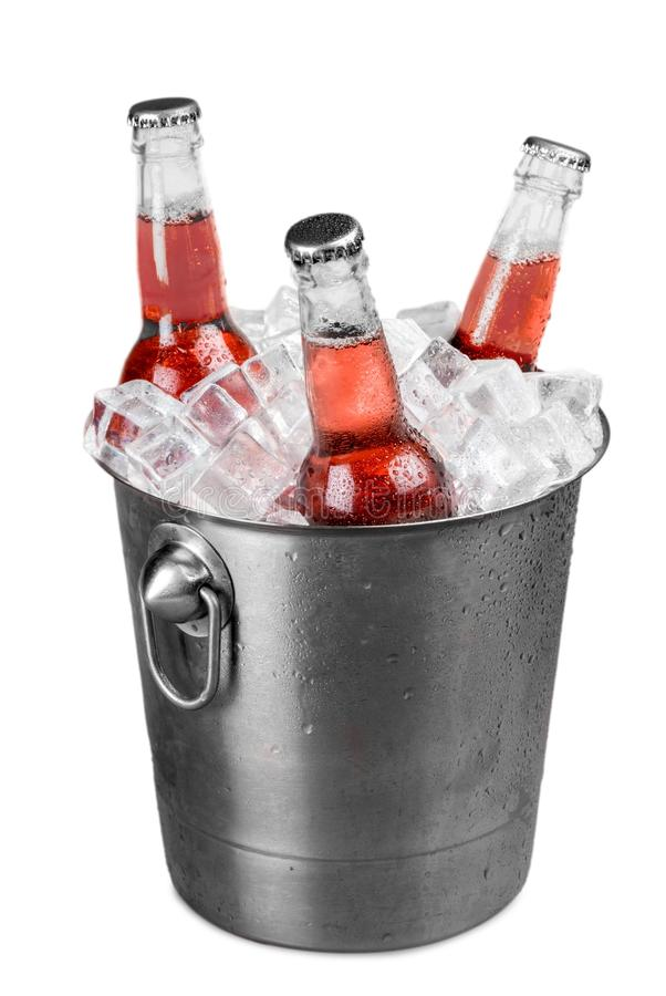 Soda bottles in a bucket filled with ice royalty free stock photos