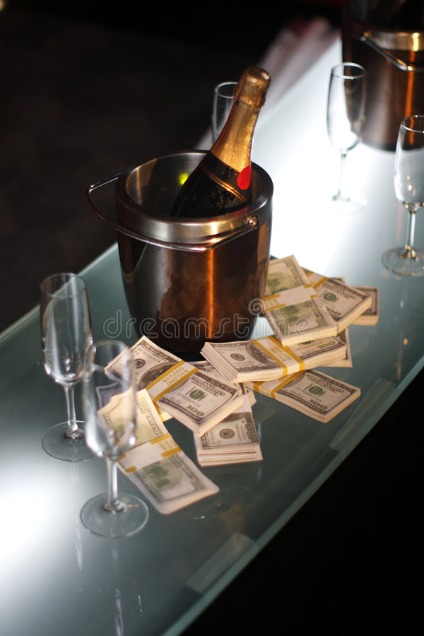 Bucket Of Champagne Next To Cash Stock Photos