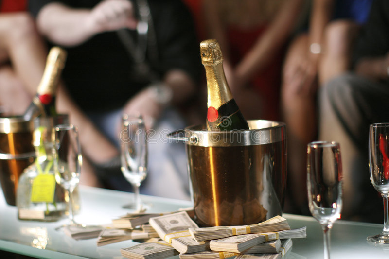 Bucket Of Champagne Next To Cash Stock Photo