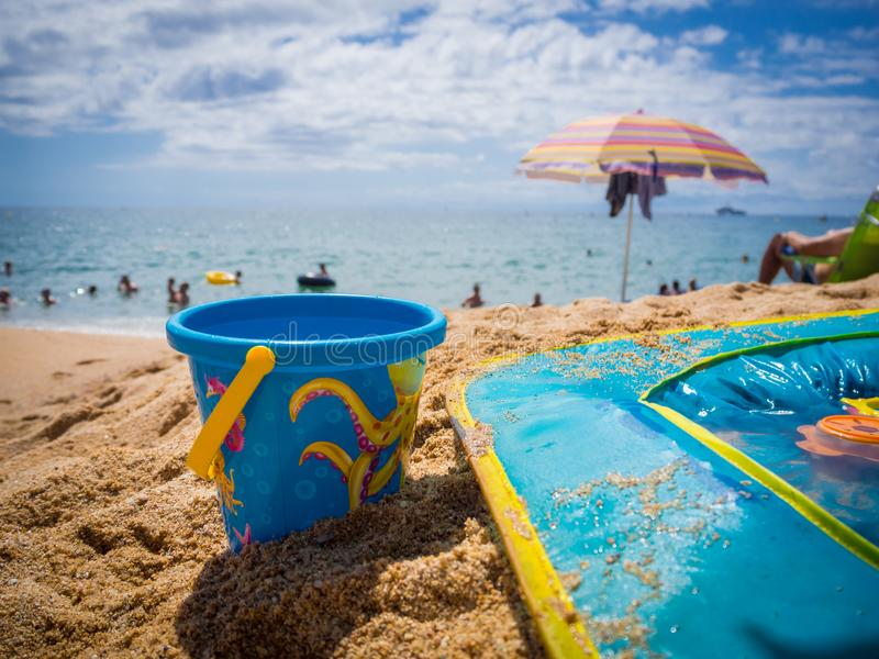 Bucket and children`s pool on the sand stock image