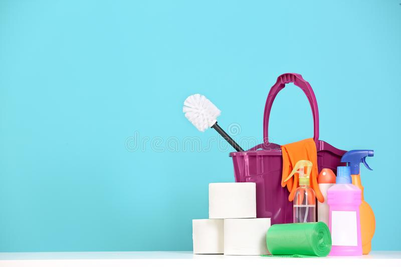 Bucket with cleaning supplies on color background. Bucket with many cleaning supplies on color background royalty free stock photos