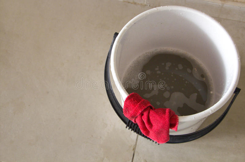 Bucket. A bucket of dirty water royalty free stock photography