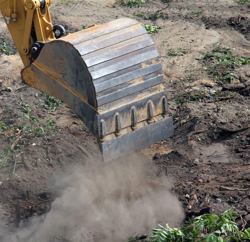 Bucket of excavator in work royalty free stock photo